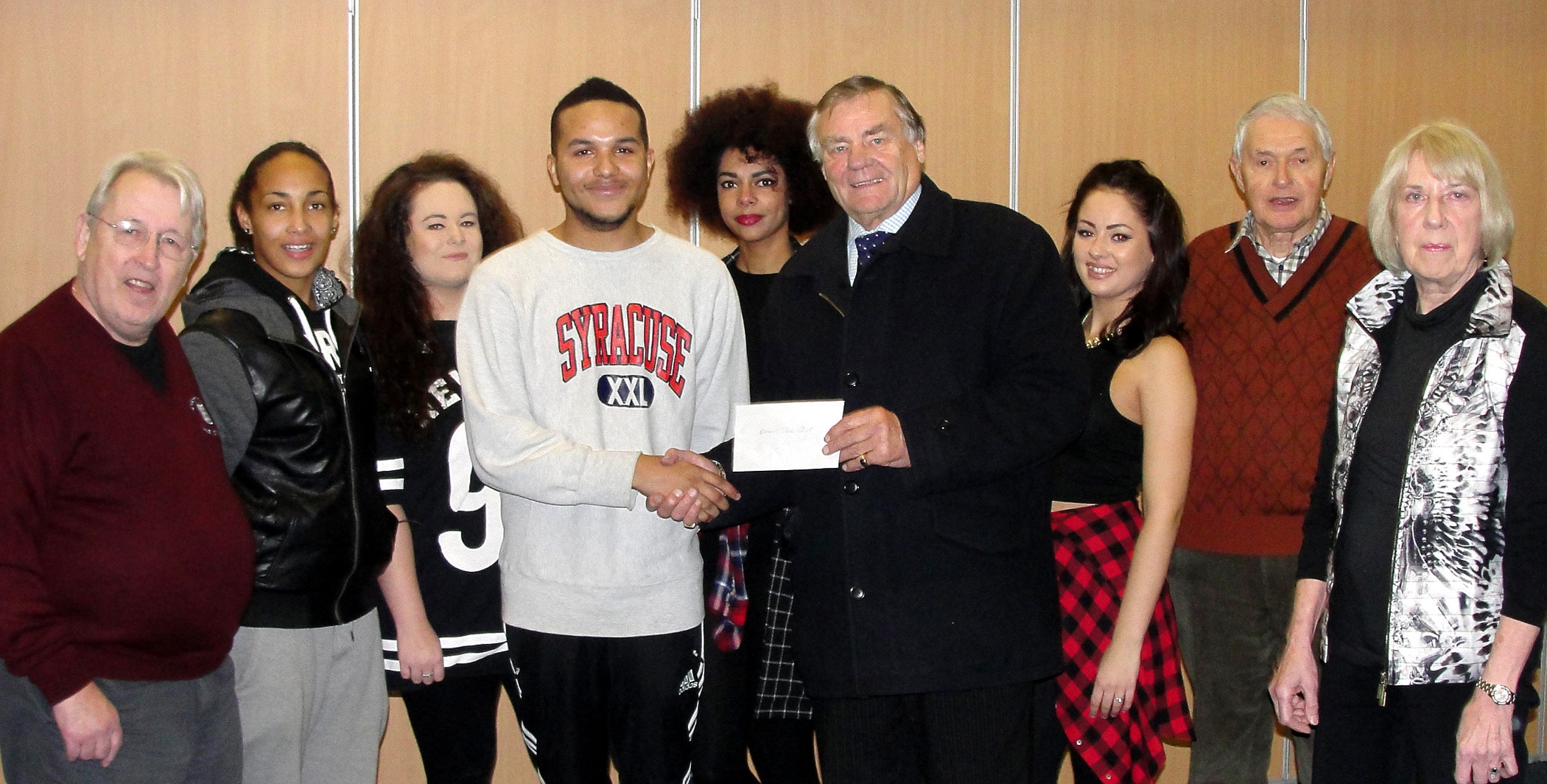 Councillor Eric Carter hands the cheque to Leven Peart of Blackout Dance Group