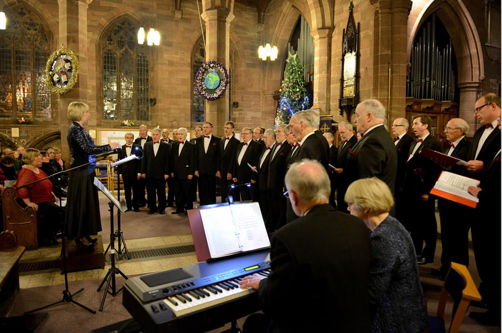 Newport (Salop) & District, accompanied by Michael Ward & Jo Ward, performing under the direction of Vivian Redfern at St Nicholas Church, Newport at our 2013 Christmas Concert.